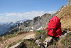 Red knapsack, against austrian mountain panorama Royalty Free Stock Photography