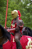 Red knight. On horseback, warwick castle, England royalty free stock photo