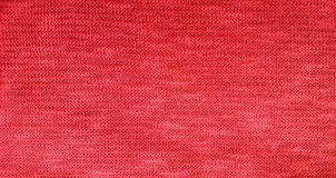 Red knit fabric textile background. Stock Image