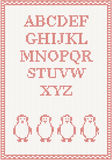 Red knitted alphabet with penguin Stock Images
