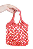 Red knitted bag on a white background Stock Photo
