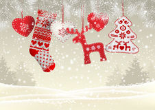 Red knitted christmas stocking with some scandinavian traditional decorations hanging on branches in front of simple Royalty Free Stock Photography