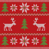 Red knitted Christmas sweater with deer and signs seamless pattern Stock Images