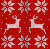 Red Knitted deers and stars sweater in Norwegian style. Knitted Royalty Free Stock Image