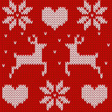 Red Knitted deers and stars sweater in Norwegian style. Knitted Royalty Free Stock Photo