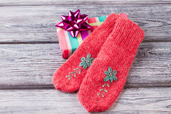 Red knitted embroidered mittens it`s great gift for the new year Royalty Free Stock Images