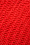 Red knitted fabric. Stock Photo