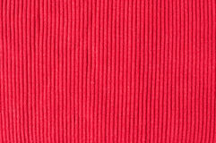 Red knitted fabric. Close up of red knitted silk fabric Royalty Free Stock Image