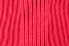 Red knitted fabric. Close up of red knitted silk fabric with vertical pattern Stock Photography