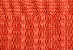 Red knitted fabric texture Stock Image