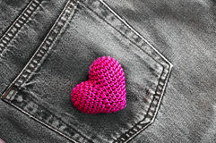 red knitted heart in the back pocket of jeans Royalty Free Stock Image