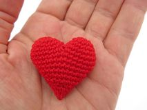 Red knitted heart in hand Stock Image