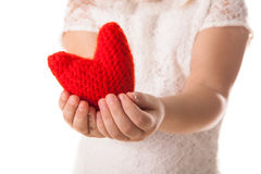 Red knitted heart in the hands of children, the concept of Valen Royalty Free Stock Images