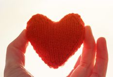 Free Red Knitted Heart Keeping My Fingers On The Background Of Sunny Royalty Free Stock Photography - 107676337
