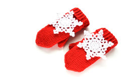 Red knitted mittens with decoration Royalty Free Stock Photography