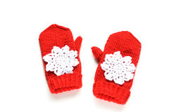Red knitted mittens with snowflakes Royalty Free Stock Photography