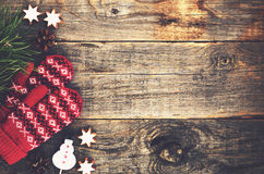 Red knitted mittens on wooden background Stock Photo