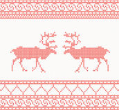 Red knitted pattern with deer Stock Images