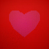 Red Knitted pattern with heart Stock Image