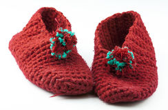 Red knitted slippers Royalty Free Stock Photo