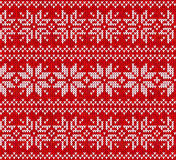 Red knitted stars sweater in Norwegian style Stock Image