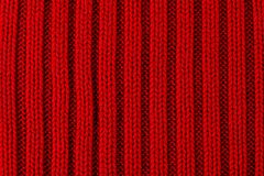Red knitted texture background Stock Photo