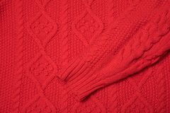 Red knitted texture with a pattern stock photo