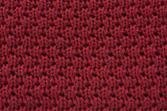 Red knitted wool fabric texture background. Bright red knitted wool fabric texture background Royalty Free Stock Photo