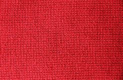 Red knitted fine wool fabric can be used as background stock photos