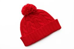 Red knitted wool hat. Isolated on white background Stock Images
