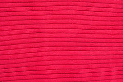 Red knitted wool texture Stock Photos