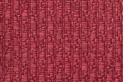 Red knitted woolen background with a pattern of soft, fleecy cloth. Texture of textile closeup. Royalty Free Stock Image