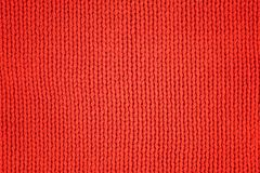 Red knitted woolen fabric as texture. Textile background stock photography
