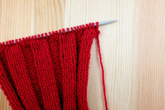 Red knitting on the needle in rib stitch Stock Photography
