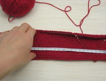 Red knitting with whole pattern Royalty Free Stock Photo