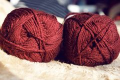 Red knitting yarns. Two red knitting yarns side by side in natural light Stock Image