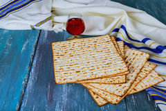 Red kosher wine with a white plate of matzah or matza and a Passover Royalty Free Stock Photography