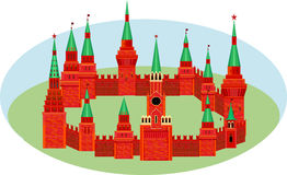 Red Kremlin are in the form of a circle on the grass. Fortress w. Ith towers and a clock Royalty Free Stock Photography