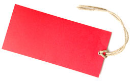 Red label isolated. A red pendant lying on white background Royalty Free Stock Photos