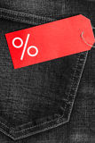 Red label with percent sign on denim Stock Photo