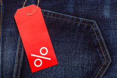 Red label with percent sign on denim Royalty Free Stock Photo