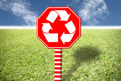 Red label with the symbol of environment on the grass and blue s Royalty Free Stock Image