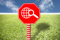 Red labels with images world on grass and blue sky. Royalty Free Stock Photography