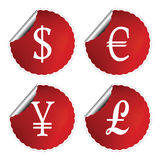 Red labels with international currency symbols Royalty Free Stock Photography