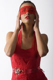 Red lace in mask. Cute and brunette in red laced shirt and a red lace mask looking up royalty free stock photos