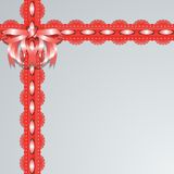 Red lace ribbons with satin bow on a gray background. Stock Images