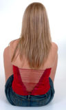 Red Laced Bodice. Blonde girl sitting on floor, wearing red laced bodice Stock Photography