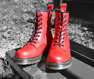 Red laced boots, on black-white background in park Stock Photos