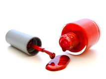 Red lacquer. Photo of the red liquid lacquer over white background Stock Images
