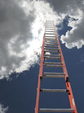 Red ladder with clouds Royalty Free Stock Photography